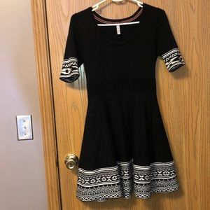 Black and white elbow sleeve dress.